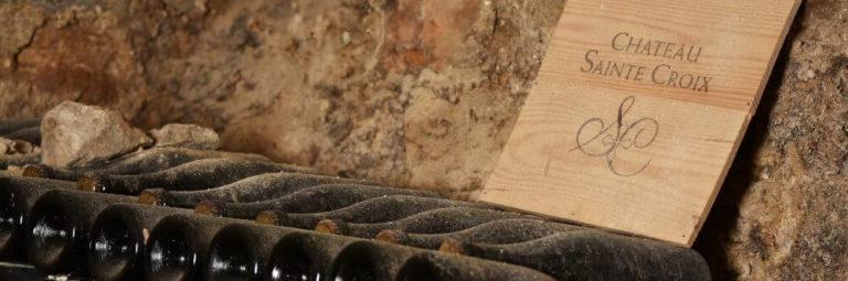 cave à vin avec des bouteilles de bulles d'ange du Château Sainte Croix